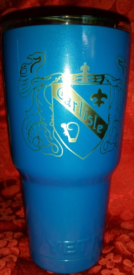 Medium blue, 30 oz Yeti tumbler, with your camp crest laser engraved on the front and the Union Carbide logo laser engraved on the back.